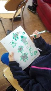 Kleine Künstlerhände zeichnen Orks