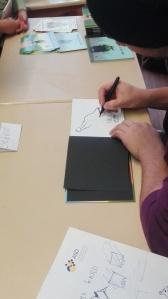 Rudy Eizenhöfer zeichnet ins Buch
